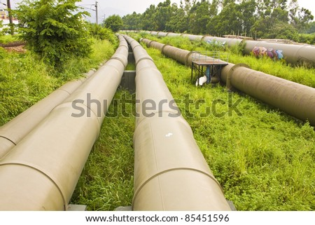 Industrial pipelines on the ground - stock photo