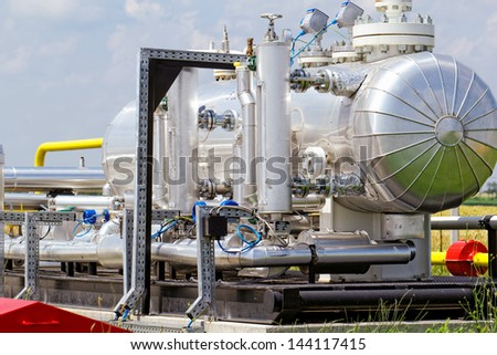 industrial pipes at an oil well