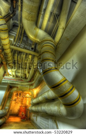Industrial pipes in a rundown facility - stock photo