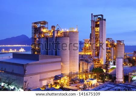 Industrial plant at dusk - stock photo