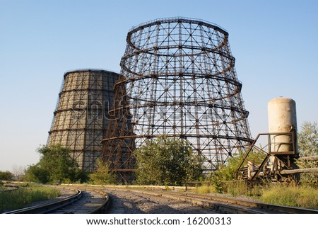 Industrial plant cooling tower and railway - stock photo