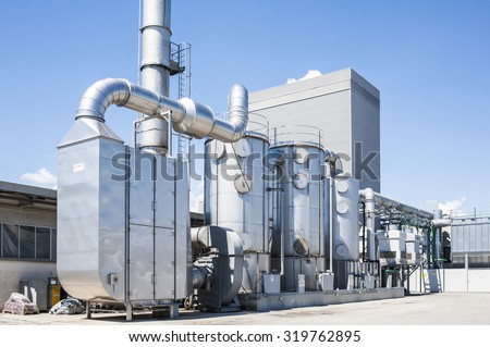 Industrial plant for filtering air polluted ponds with tanks, and water tanks - stock photo