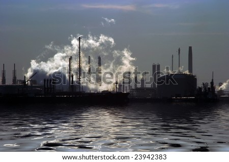 industrial plant on the edge of water - stock photo