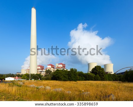 Industrial plant with chimney and cooling towers  - stock photo