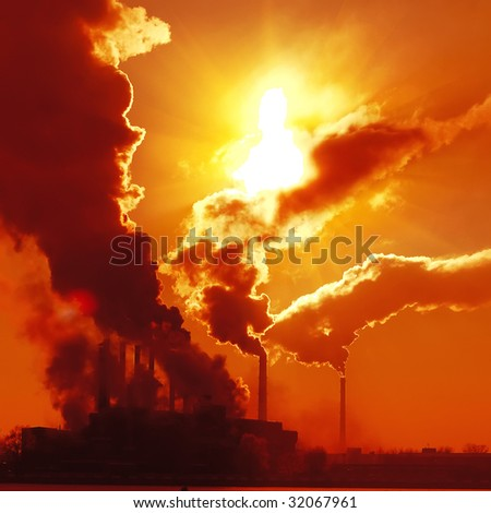 Industrial plant with smoke - stock photo