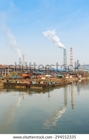 Industrial plant with smoke stacks, industrial area - stock photo