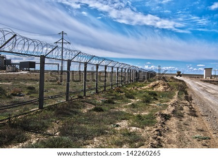Industrial platform against the cloudy sky in the desert of Central Asia - stock photo
