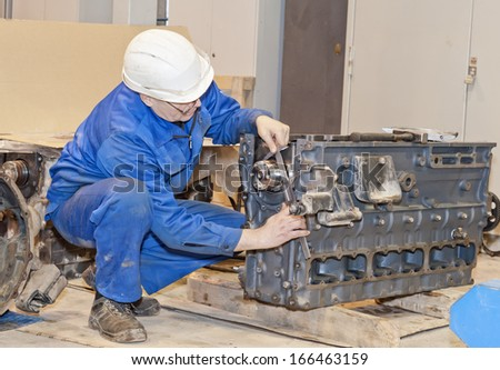 Industrial platform. The mechanic does detail measurement. Engine repair. - stock photo