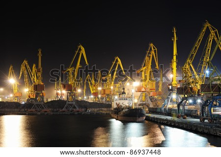 industrial port and ship at night - stock photo