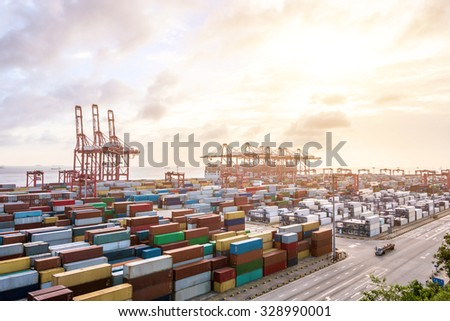 Industrial port at dawn at the Port of shanghai - stock photo