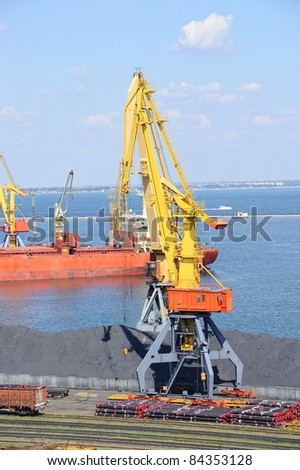 Industrial port with cargo. Coal, tubes, ship, cranes. Railroad and car. - stock photo