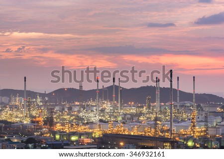 industrial power plant oil station night landscape with lights at sunset - stock photo