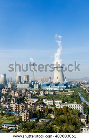Industrial power plant smoke pollution in urban suburb - stock photo