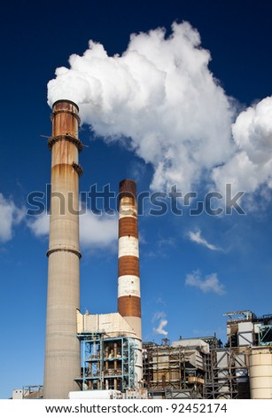 Industrial power plant with smokestack - stock photo