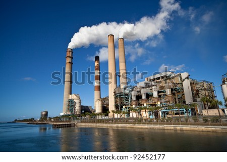 Industrial power plant with smokestack