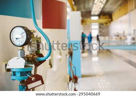 industrial power pressure Barometer and workers in Hydroelectric Dam - stock photo