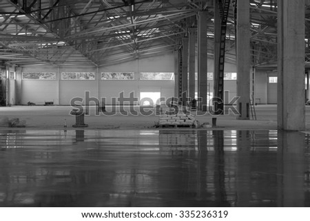 industrial premises in the construction process without people, in black and white - stock photo