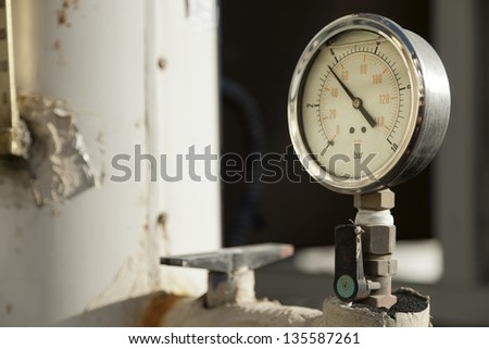 Industrial pressure gauge on a water pipe. - stock photo