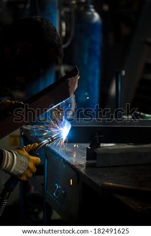 Industrial professional worker welding metal - stock photo