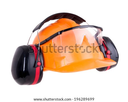 Industrial protection set including hard hat, safety goggles and earmuffs shot on white - stock photo