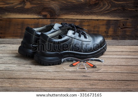 Industrial Protective Workwear. Includes safety shoes And Eyewear. - stock photo