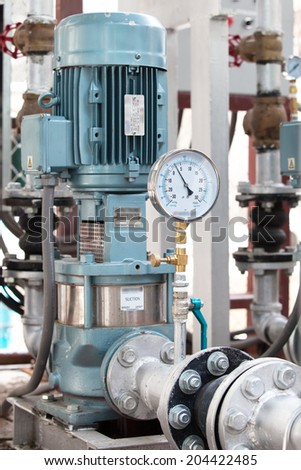 Industrial Pump with pressure guage in Factory - stock photo