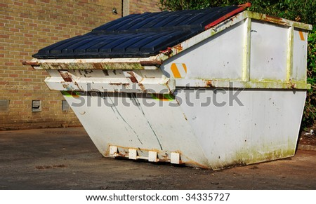 industrial recycle skip with trash waste outside - stock photo