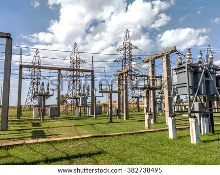 Industrial reduces power station. Power transformer on ceramic and porcelain insulators wire line transmission electron - stock photo