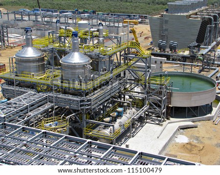 Industrial refinery plant with cooling tower - stock photo
