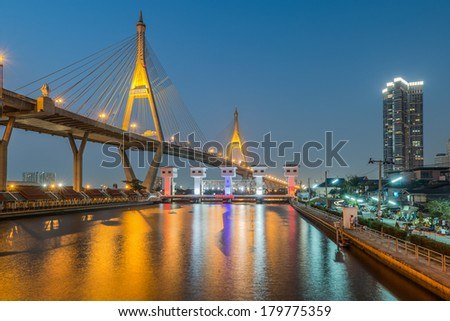 Industrial ring road and floodgate at night , Bangkok, Thailand