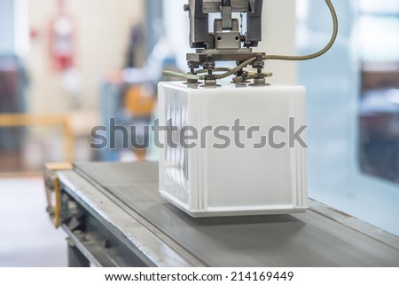 Industrial robot working in factory - stock photo