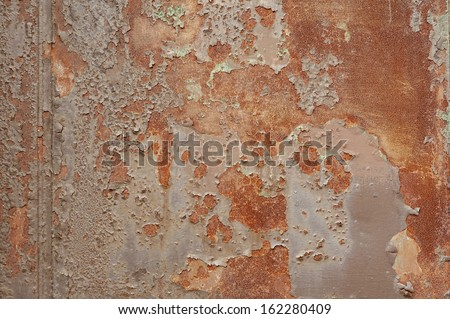 Industrial rusty metal background texture with flaking and peeling paint - stock photo