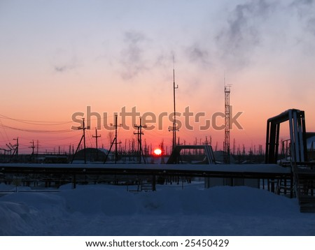 Industrial scene. Colorful sunrise on a refinery center - stock photo