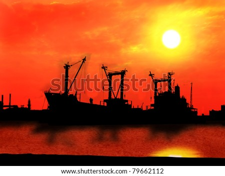 industrial ship and factory silhouetted at sunset - stock photo