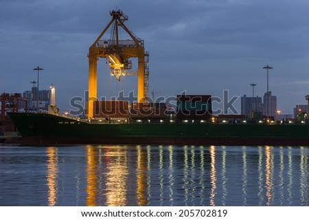 Industrial shipping port at dawn in Bangkok, Thailand - stock photo