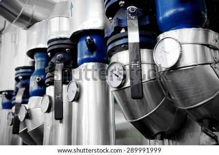 Industrial shot with a manometers and heating pipelines inside a water heating station - stock photo