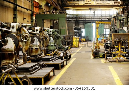 Industrial shot with the interior of an old heavy duty factory - stock photo