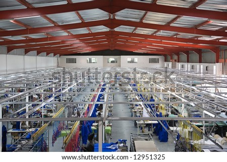 Industrial size textile factory in Africa, African workers on the production line - stock photo