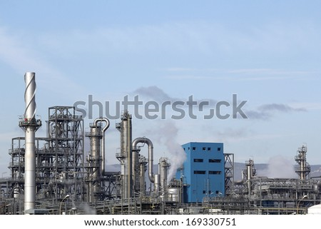Industrial smoke from chimney in a refinery