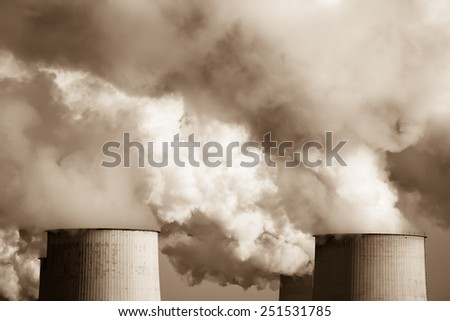 Industrial smoke from chimney on sunset, /sepia/ - stock photo