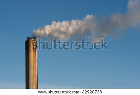 industrial smokestack on sky background