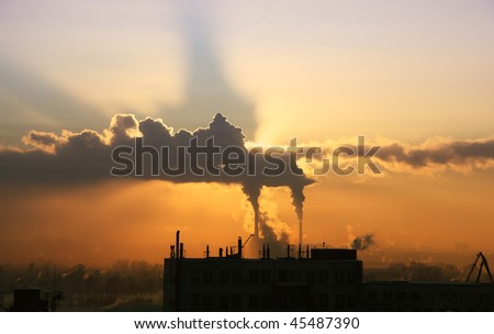 Industrial smokestacks with billowing  smoke being pumped into the atmosphere