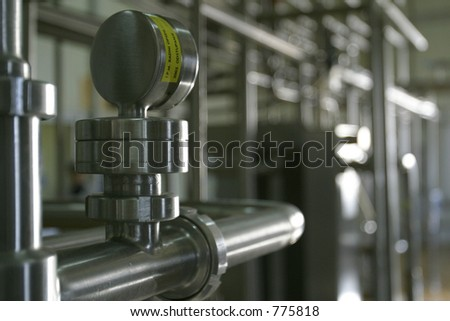 industrial stainless steel pipe work and valve - stock photo