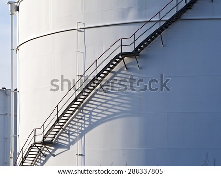 industrial stair at white oil tank - stock photo