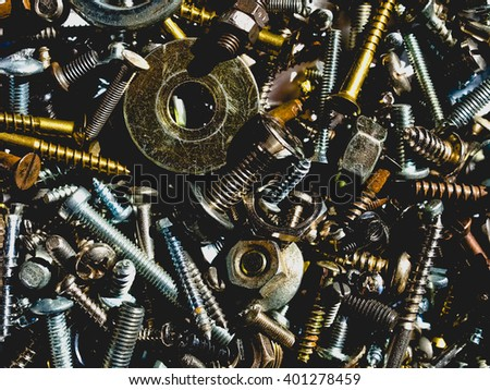 Industrial steel hardware bolts, nuts, screws with altered colours, clipped shadows, grunge look