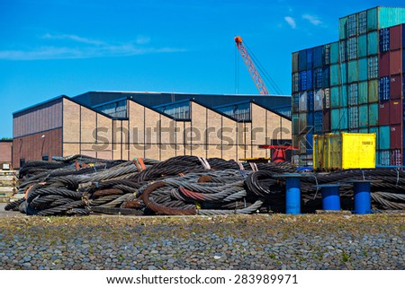 Industrial steel ropes in cargo terminal of Rotterdam Port - stock photo