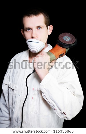 Industrial Steel Working Man Wearing White Overalls Holding Angle Grinder On Black Background - stock photo