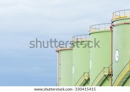 Industrial Storage Tanks. Oil tanks in line - stock photo