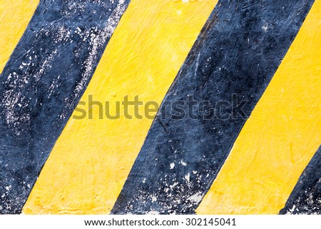 Industrial striped road warning yellow-black pattern. - stock photo