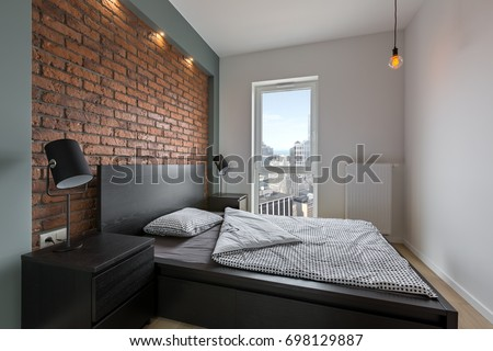 Beau Industrial Style Bedroom With Red, Brick Wall And Double Bed
